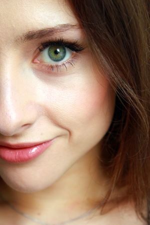 The half face of beautiful girl with attractive eyes photo