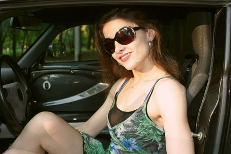 The beautiful girl in the car photo