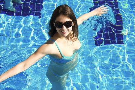 Sexual girl is swimming in blue swimming pool Stock Photo - 9007895