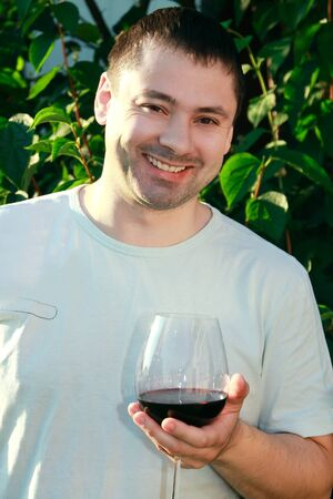 Handsome man drinking wine outdoor with happy smiling Stock Photo - 10283210