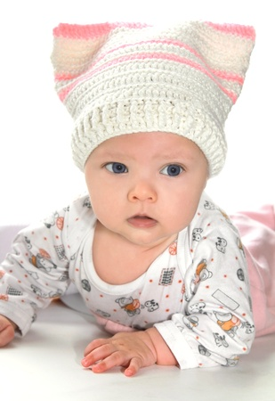 Closeup portrait of beautiful baby girl in fun hat photo