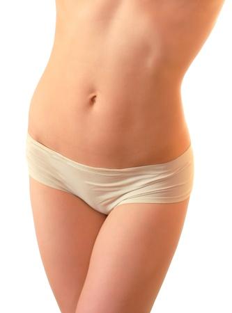 Bella giovane donna sottile addome perfetto isolato su sfondo bianco Archivio Fotografico - 12202988