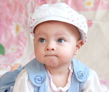 Closeup portrait of adorable baby girl in cap with funny look Stock Photo - 12202985