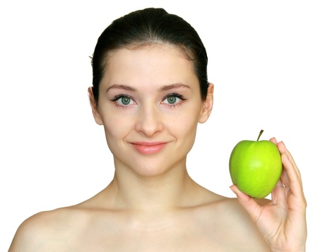 Beautiful young woman holding the green apple isolated on white background Stock Photo - 12361826