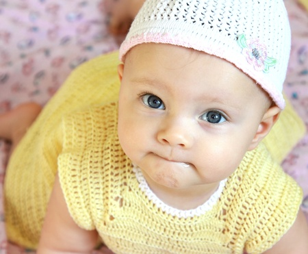 Closeup portrait of beautiful funny girl with blue eyes in pretty hat looking in camera Stock Photo - 12615042