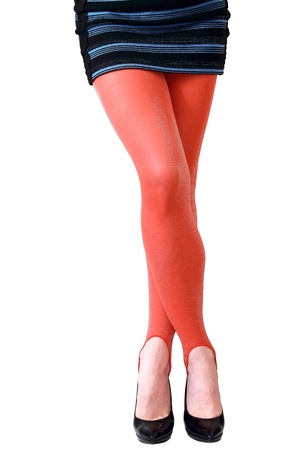 Slim long female crossed legs in red bright modern tights and short blue dress isolated on white background Stock Photo - 13053088