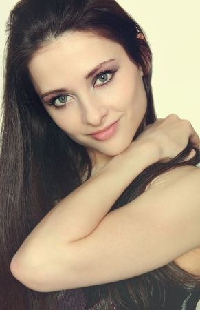 Closeup portrait of beautiful girl with long hair holding the hand on shoulder and sexy look Stock Photo - 13352444