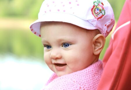 Happy smiling baby in hat looking outdoor  Closeup portrait Stock Photo - 13654007