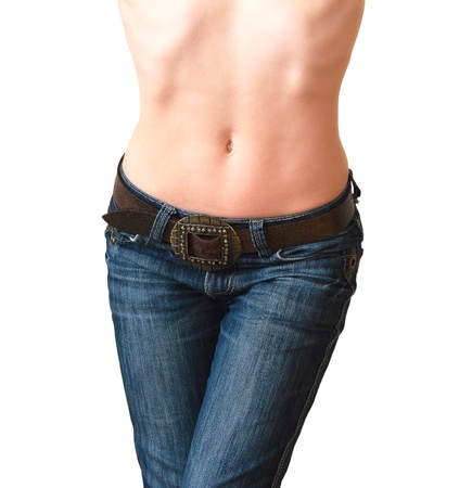 Beautiful woman in jeans with naked stomach and modern leather belt posing isolated on white background photo