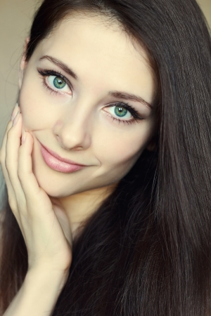 Portrait of beautiful woman touching clean face with green eyes and long hair  Closeup beauty Stock Photo - 13828511