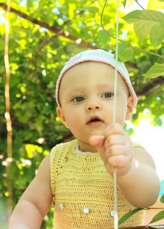 Beautiful baby girl in hat outdoor on summer green trees background  Portrait Stock Photo - 14122969