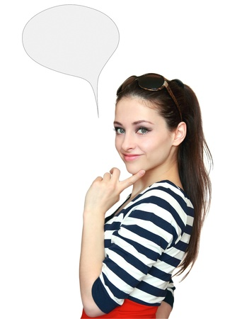 Beautiful teenage girl thinking with blank thought bubble isolated holding finger on the face photo