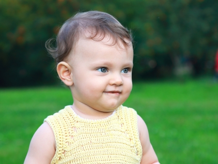 Beautiful smiling baby girl on nature summer  Closeup portrait Stock Photo - 14715969