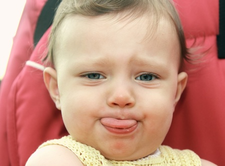 Fun baby showing the tongue playing up  Closeup portrait Stock Photo - 14925199