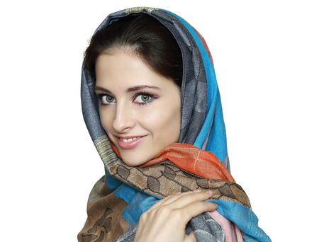 Beautiful smiling woman in colorful shawl isolated on white background  Close portrait photo