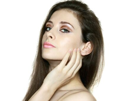 Beauty woman face closeup portrait holding hand clean skin isolated on white background  White beautiful model with health skin Stock Photo - 15720961