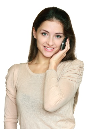 Young smiling woman talking mobile phone isolated on white background  Closeup portrait of happy white teen holding telephone and looking in camera photo