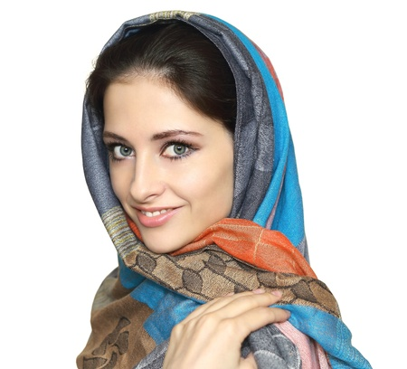 Beautiful smiling woman in colorful shawl isolated on white background  Close portrait