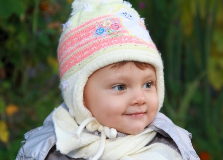 Smiling baby in white hat outdoor autumn background  Closeup portrait Stock Photo - 15880484