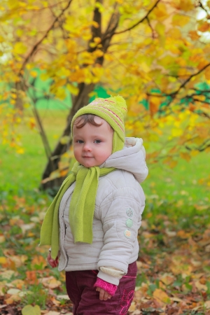 Happy child standing outdoors yellow autumn  Portrait of little girl in hat Stock Photo - 15971261