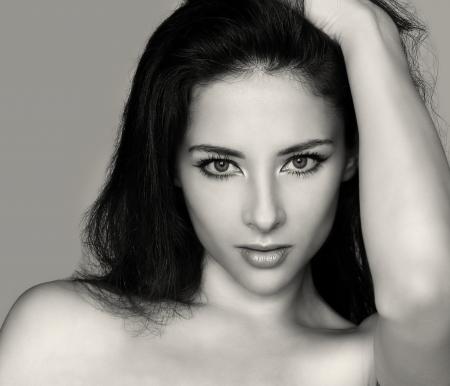 Vogue sexy beautiful woman face  Art fashion closeup portrait of sexy girl holding hair Stock Photo - 16242600