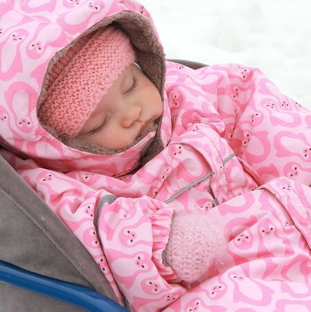 Baby sleeping outdoors winter background in warm dress  Closeup portrait Stock Photo - 17057135