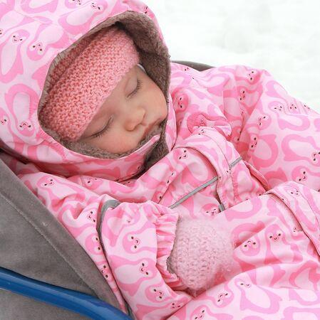 Baby sleeping outdoors winter background in warm dress  Closeup portrait Stock Photo - 17057135