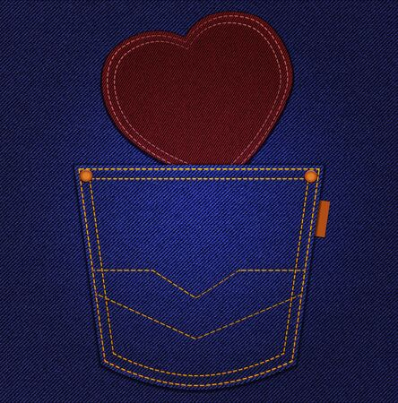 Red heart in jeans pocket on blue denim background photo