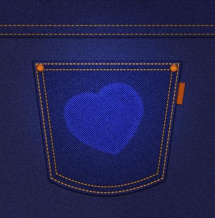 Heart on jeans pocket on blue denim background photo