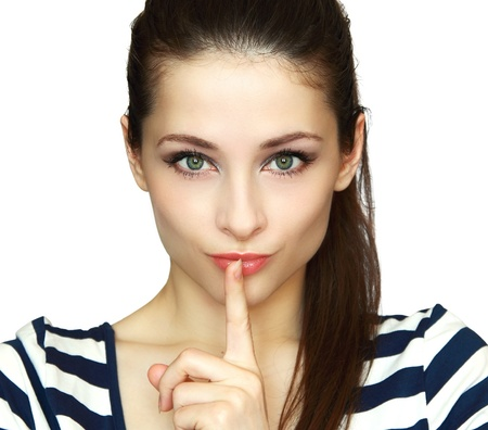 Secret woman  Female showing hand silence sign isolated on white background photo