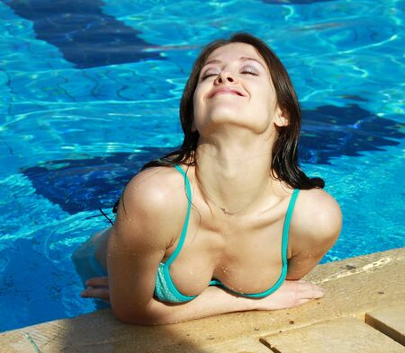 wet bikini: Happy woman enjoying in swimming pool with smile  Holidays