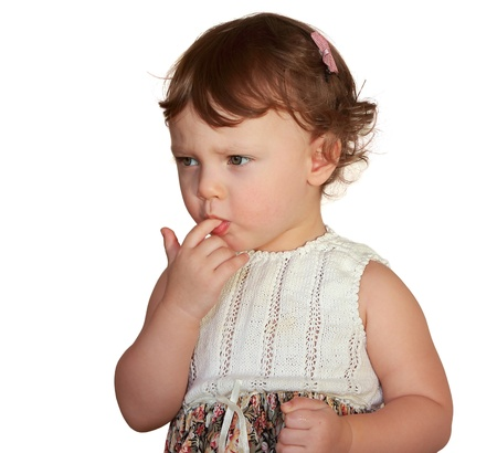 Baby sucking finger with thinking serious look isolated on white background Stock Photo - 17536891