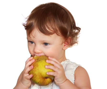 Baby eating yellow fruit pear isolated on white background Stock Photo - 17536888