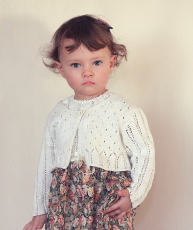 Kid girl model posing in fashion beautiful dress with serious face Stock Photo - 17605155