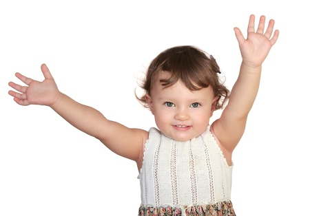Happy baby holding hands up and smiling isolated Stock Photo - 17605157