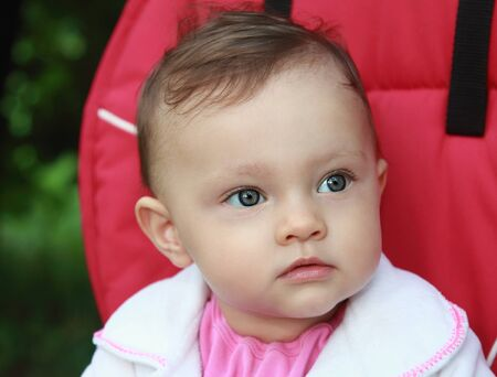 Fun baby in buggy looking big eyes on summer  Closeup portrait Stock Photo - 17700641