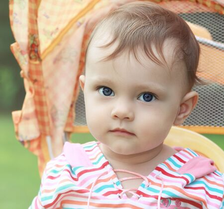 Baby girl looking blue eyes outdoors summer background  Closeup portrait Stock Photo - 17792864