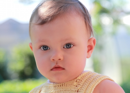 Fun baby outdoors background  Closeup portrait Stock Photo - 18006924