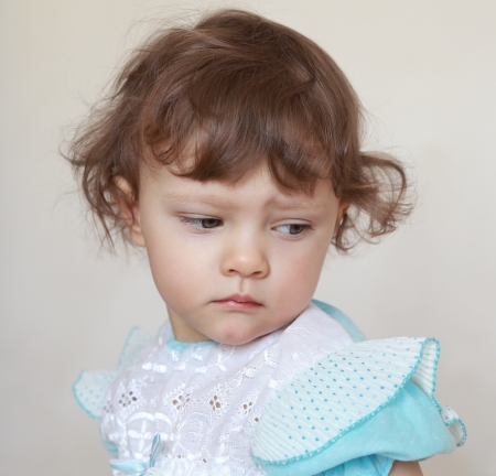 Sad baby girl looking down  Closeup portrait Stock Photo - 18258128