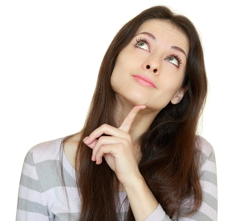 Thinking girl looking up with finger at face with smile isolated on white background  Closeup portrait Stock Photo