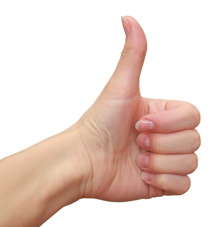 Thumb up sign by woman hand isolated on white background Stock Photo - 18563259