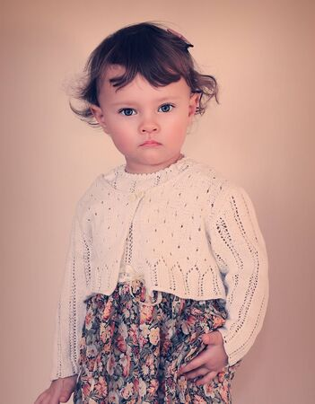 Fashion baby girl posing in modern dress  Photo in vintage color style Stock Photo - 18763004