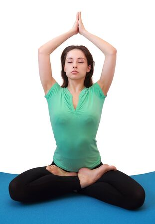 Woman relaxing in yoga position with closed eyes and hand up isolated on white background Stock Photo - 18768341