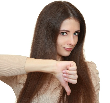 unsuccessful: Woman with thumb down sign and looking angry isolated on white background  Closeup portrait