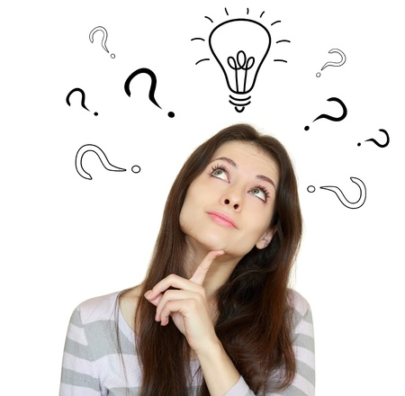 Thinking woman with question signs and light idea bulb above isolated on white photo