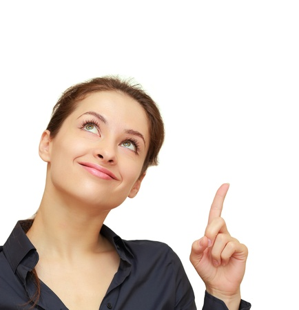 Smiling business woman showing finger up and looking above isolated on white background