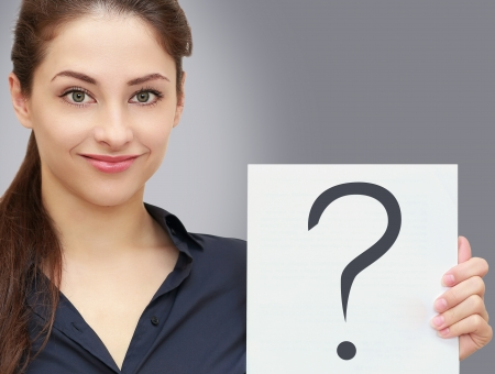 Business woman holding blank with request question sign on grey background  Closeup portrait Stock Photo - 19761505