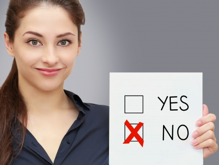 cross mark: Business woman holding blank and voting for no in option on grey background