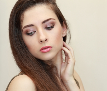 Beautiful makeup woman face looking down  Closeup portrait Stock Photo - 20057274
