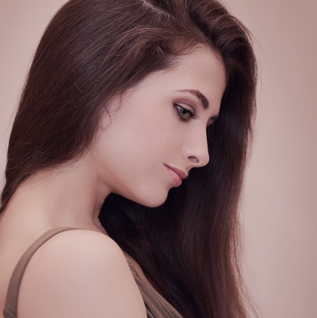 Beautiful woman profile with long hair looking down  Art portrait Stock Photo - 20085537